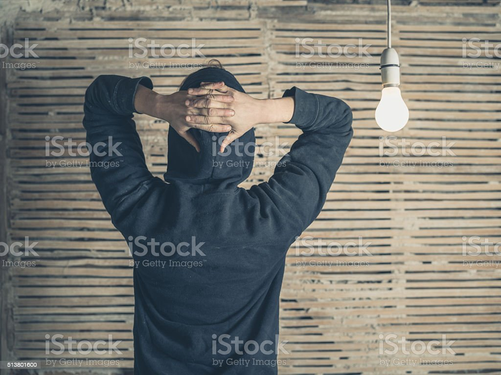 Rear view of person by light bulb stock photo