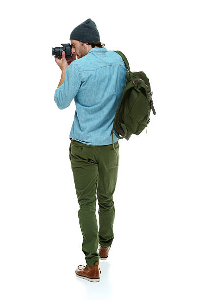 Rear view of photographer in action with camera picture id613884196?b=1&k=6&m=613884196&s=612x612&w=0&h=rmu5bmwpxy krd5elbxuoo2ahutkpoiva5sdmfjujme=