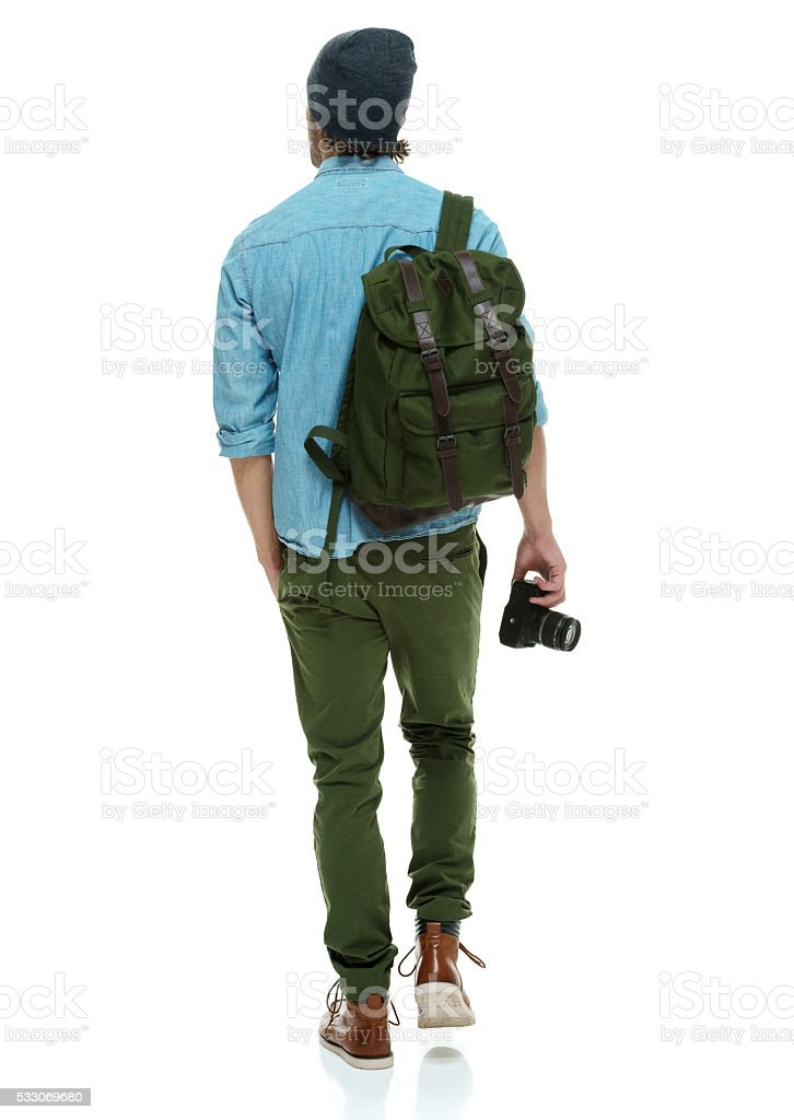 Rear view of photographer walking stock photo