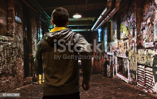 istock Rear view of runner running out in the city 524652985