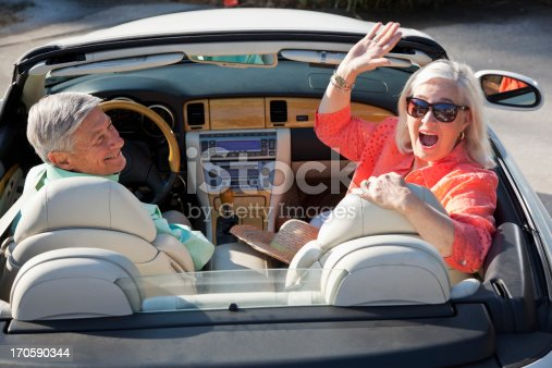108329737istockphoto Rear view of senior couple in convertible 170590344