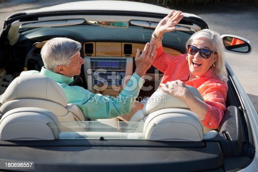 108329737istockphoto Rear view of senior couple in convertible 180698557