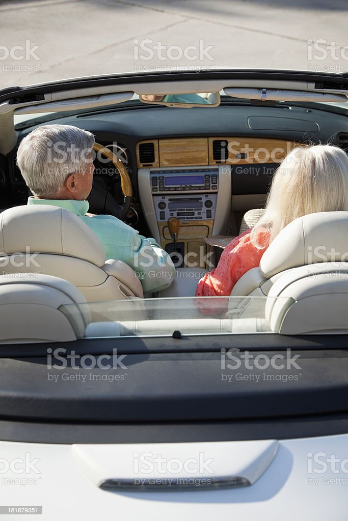 Rear view of senior couple in convertible royalty-free stock photo