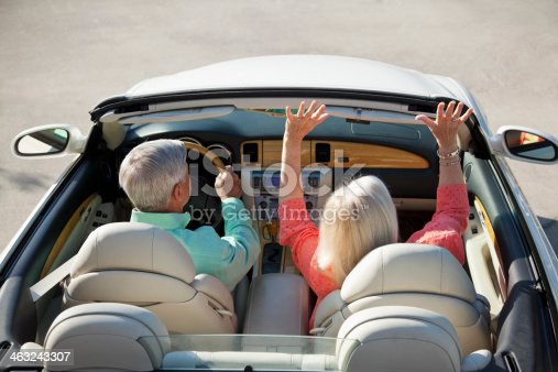 108329737istockphoto Rear view of senior couple in convertible 463243307