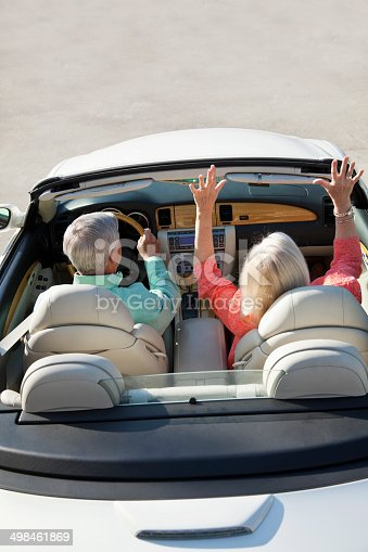 108329737istockphoto Rear view of senior couple in convertible 498461869