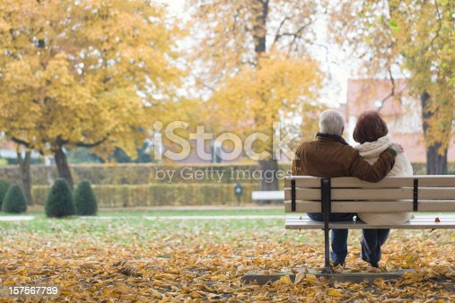 Rearview shot of a senior couple relaxing on a park bench