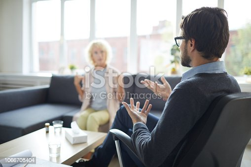 Psychologist commenting mental state of patient at therapy session