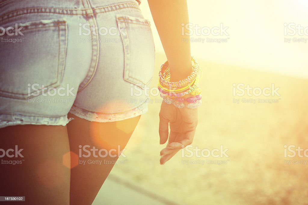 Rear view of sexy woman in jeans, closeup on buttocks stock photo