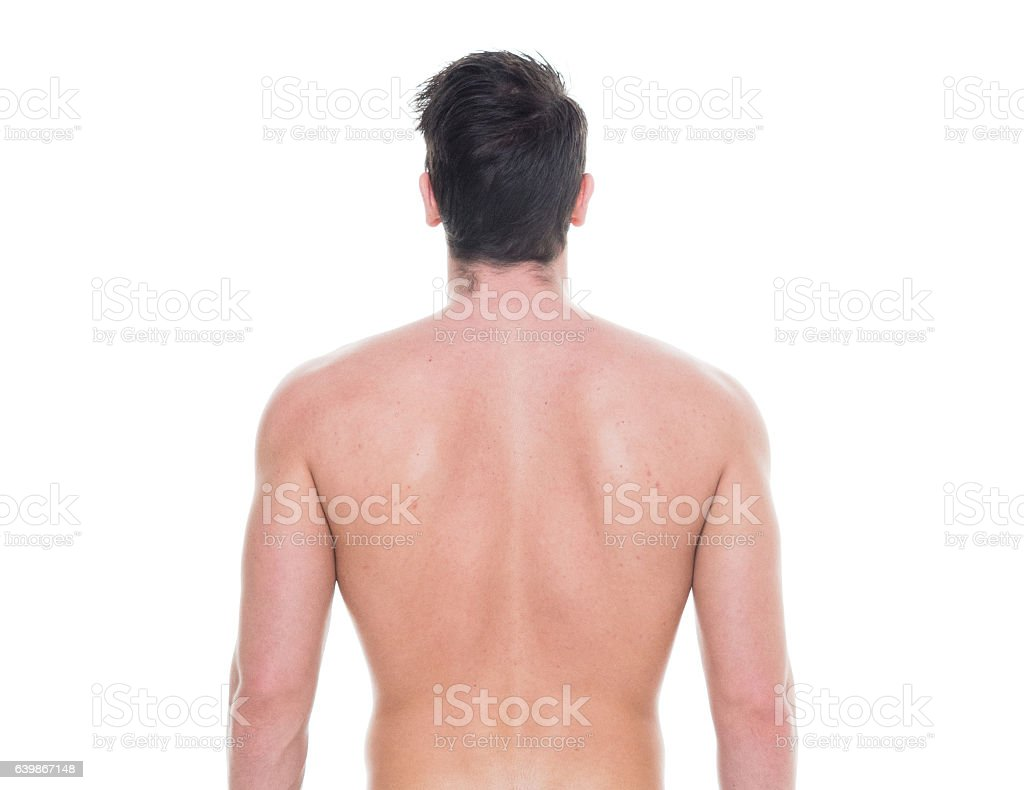 Rear view of shirtless man looking away stock photo