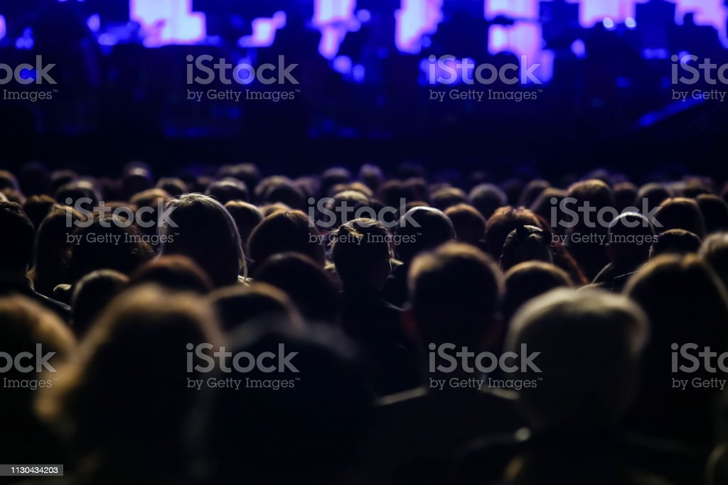 Rear view of sitting audience stock photo