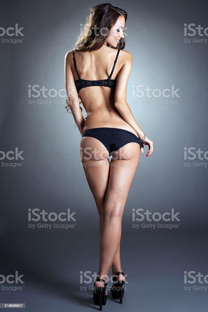 Rear view of slim tanned underwear model stock photo