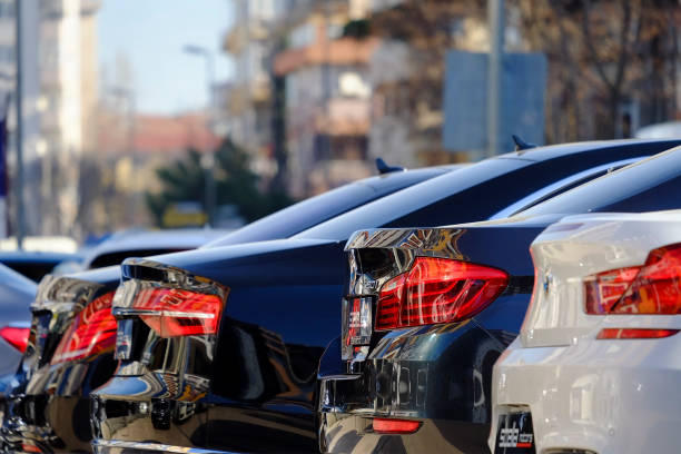 Rear View of Some New German Cars Istanbul, Turkey - March 4, 2017: Rear view of some new German Cars. Like Bmw 520i, Mercedes Benz and Audi in a car dealership at The Istanbul Kadikoy District. There are blurry buildings and trees at the background too. vehicle brand name stock pictures, royalty-free photos & images