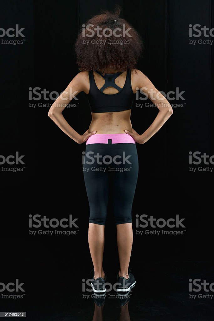 Rear view of sports woman standing stock photo