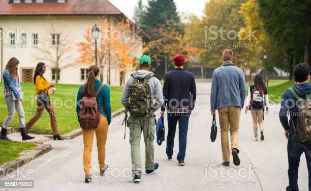 Rear view of students walking through the park picture id858079302?b=1&k=6&m=858079302&s=612x612&h=thdfb hsgu7klb54cwflfg0rnoncztxwnj9mmw i7dy=