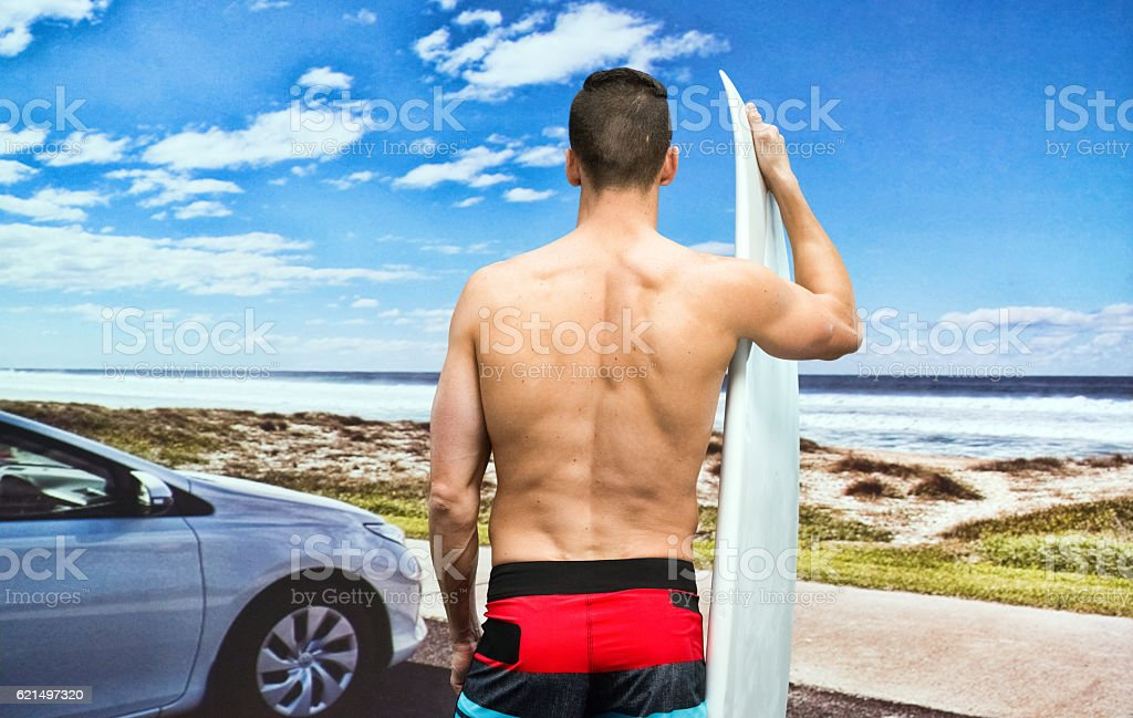 Rear view of surfer standing outdoors Lizenzfreies stock-foto