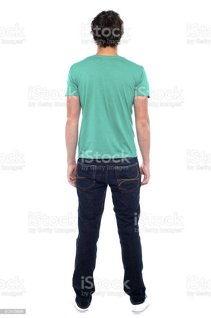 Rear view of teen guy in casuals stock photo
