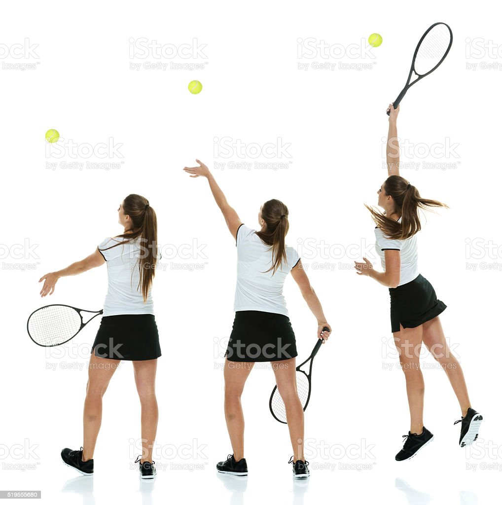 Rear view of tennis player serving the ball stock photo