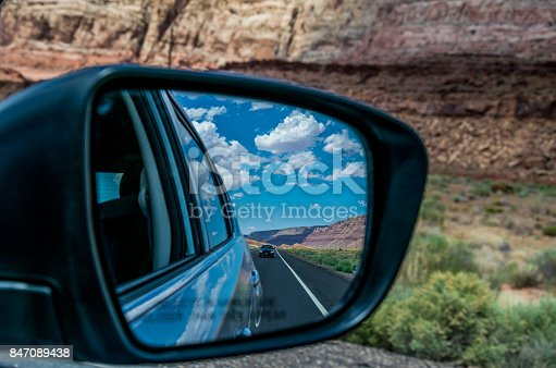 144334852istockphoto Rear view of the road in the side mirror of the car. Cars on the Highway in Arizona 847089438