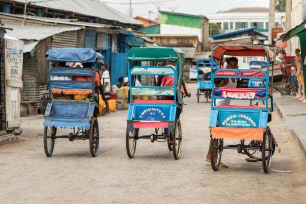 Rear view of three cycle pousse pousse at the commercial center of Toliara, Madagascar. stock photo