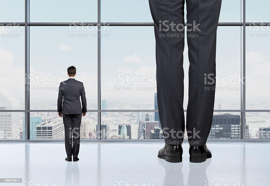 Rear view of two professionals in formal suites stock photo