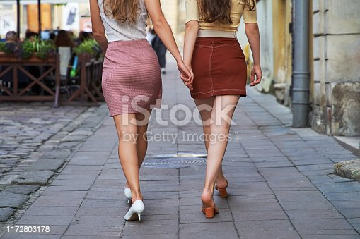 Young beautiful girls dressed in retro vintage style enjoying the old european city summertime lifestyle