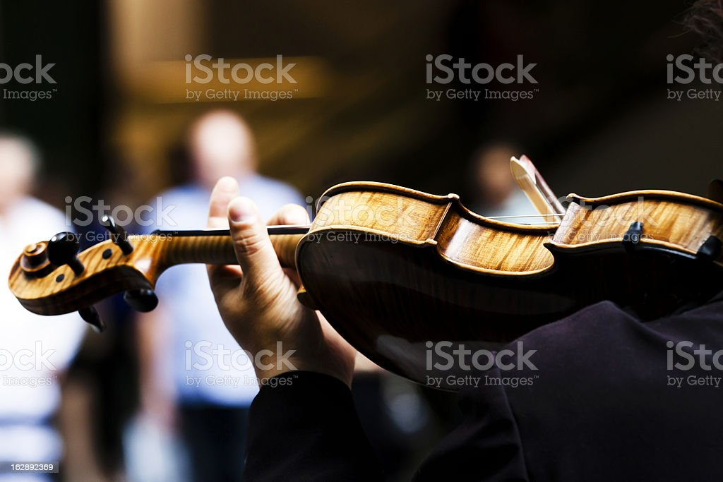 Rear view of violinist hand playin violin, copy space stock photo