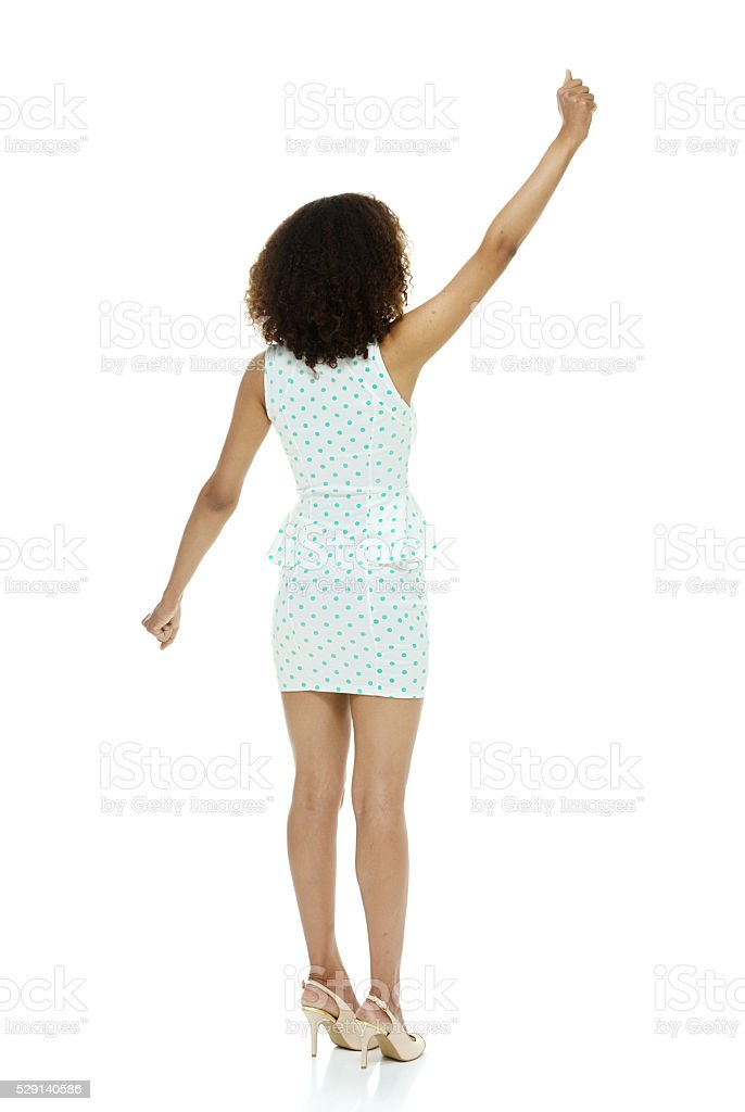 Rear view of woman cheering stock photo