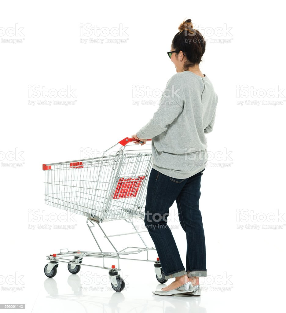 Rear view of woman holding shopping cart royalty-free stock photo