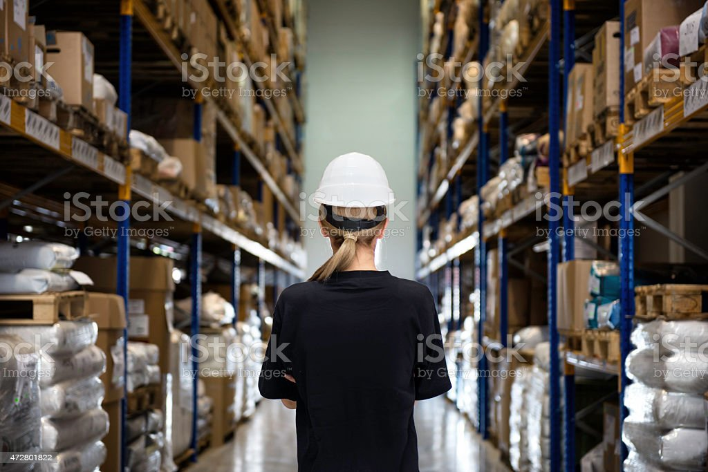 Rear view of woman in warehouse stock photo
