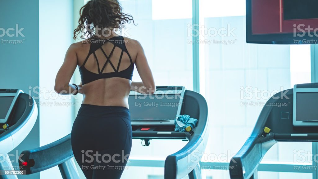 Rear view of woman on treadmill royalty-free stock photo