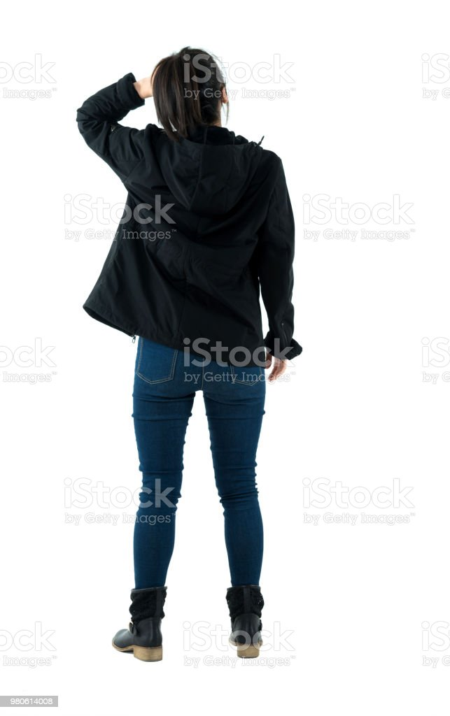 Rear view of woman scratching her head stock photo