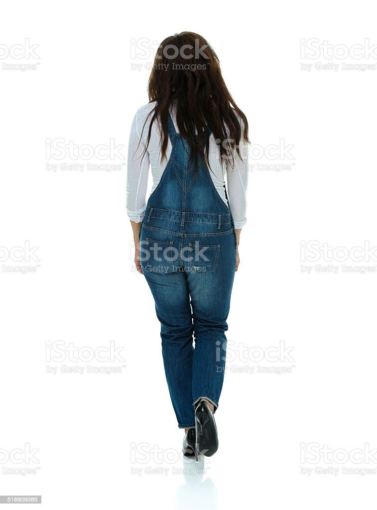 Rear view of woman walking stock photo
