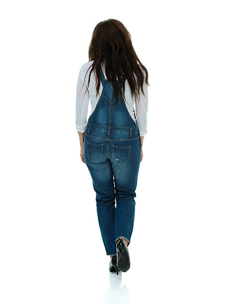 Rear view of woman walking stock photo