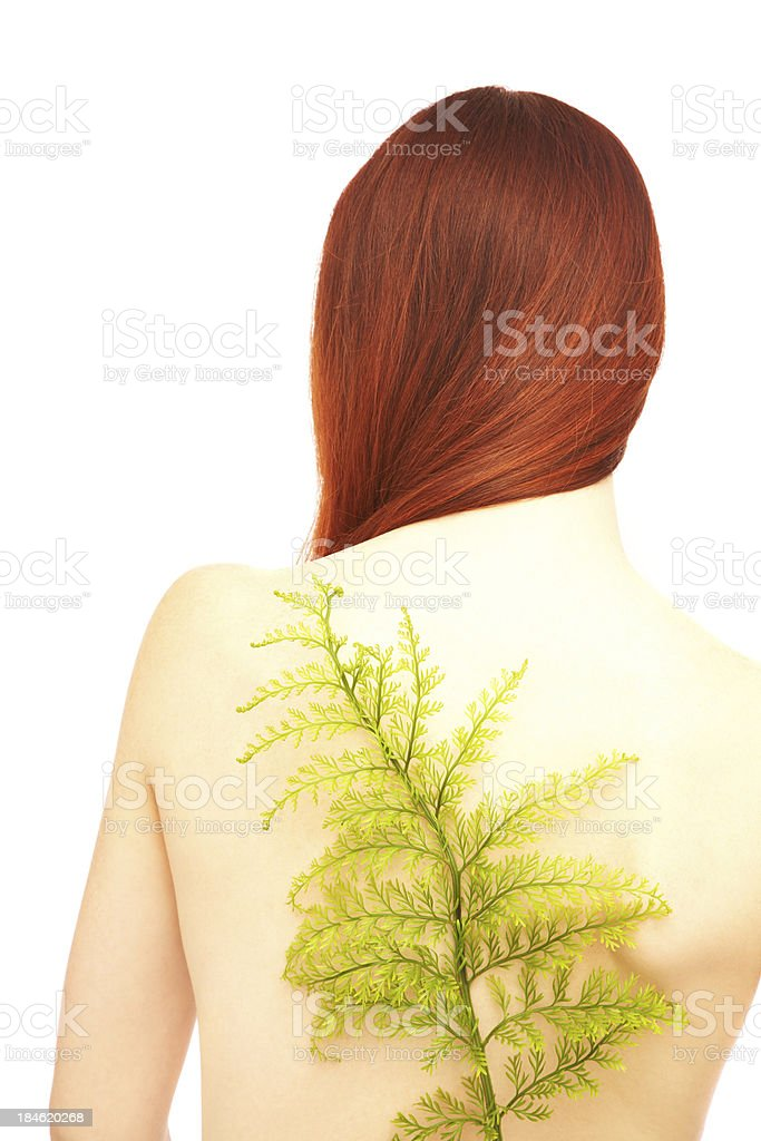 Rear view of woman with green branch over her back royalty-free stock photo