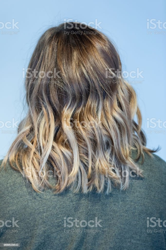 Rear view of woman with wavy hair stock photo