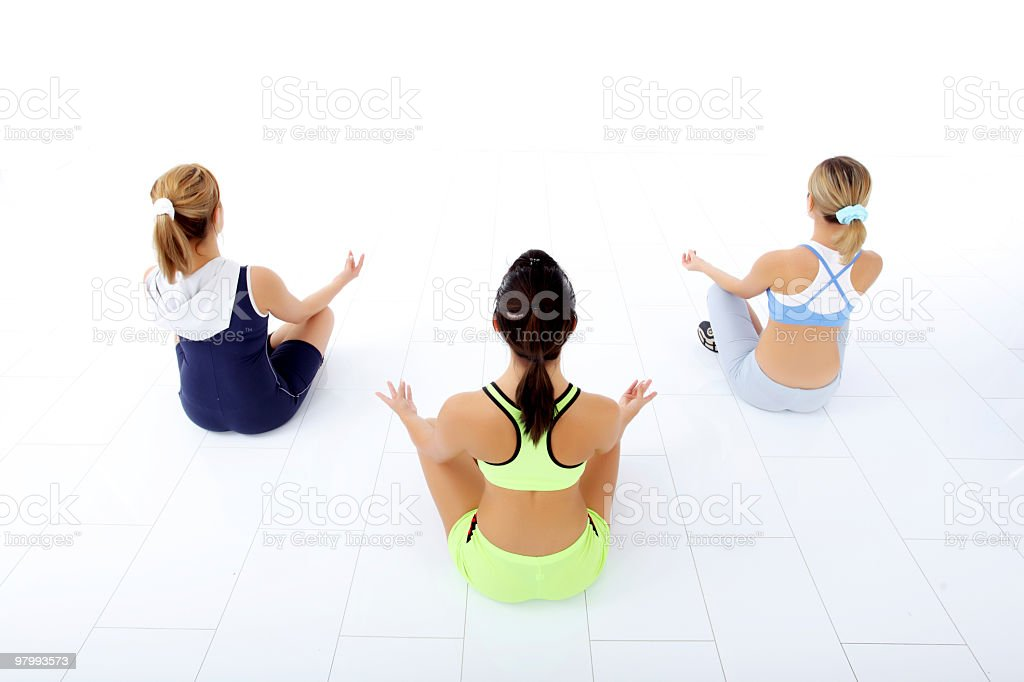 Rear view of women doing yoga. royalty free stockfoto