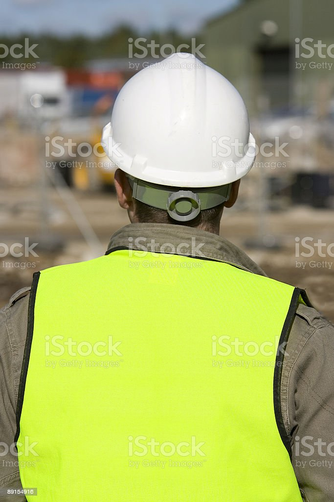 Rear View Of Worker or Foreman On Industrial Building Site stock photo