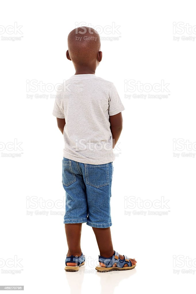 rear view of young african boy stock photo