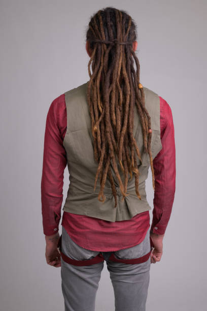 Rear view of young businessman with dreadlocks Studio shot of young handsome businessman with dreadlocks against white background rastafarian stock pictures, royalty-free photos & images