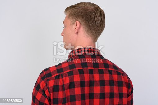 Studio shot of young handsome hipster man with blond hair against white background