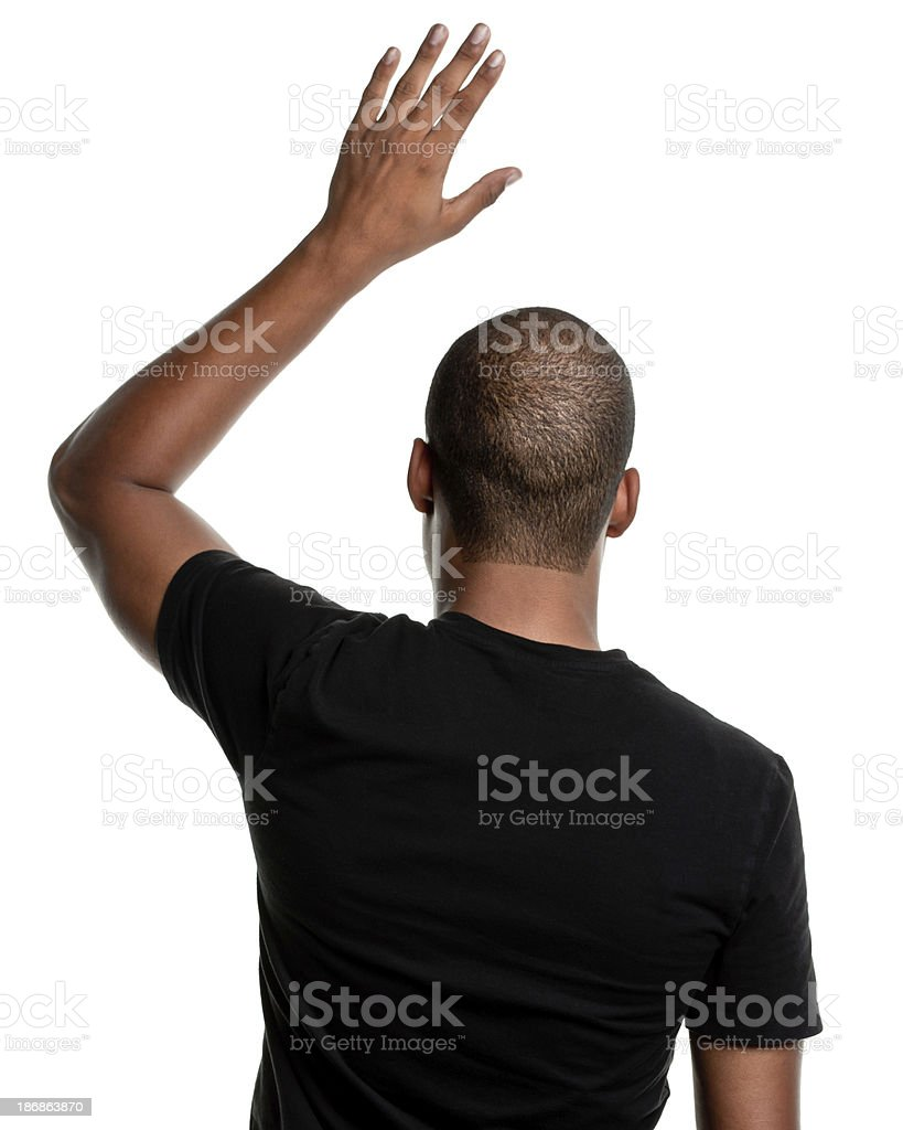 Rear View of Young Man, Hand Raised Asking Question stock photo