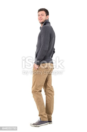 834639402istockphoto Rear view of young man in jumper smiling at camera 646050700