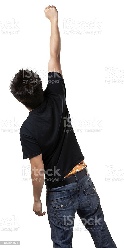 Rear View of Young Man Raising Fist royalty-free stock photo