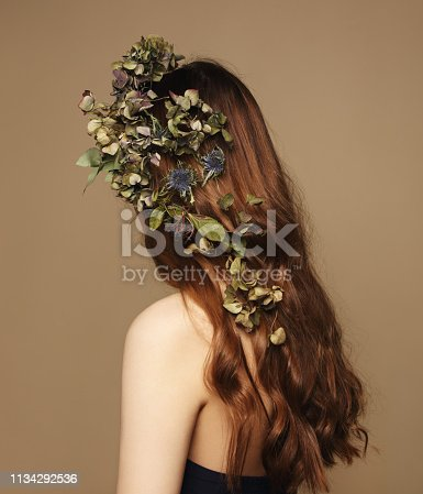 Portrait of woman with flowers in her hair