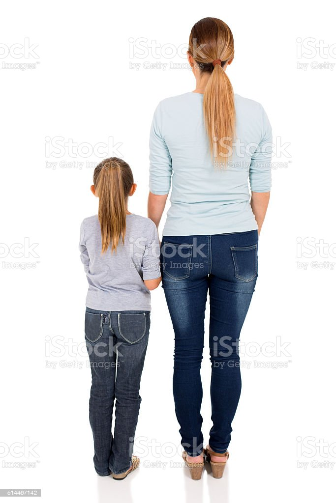 rear view of young woman and her daughter stock photo