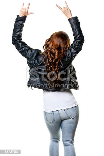 istock Rear View of Young Woman With Arms Up Gesturing 183237631