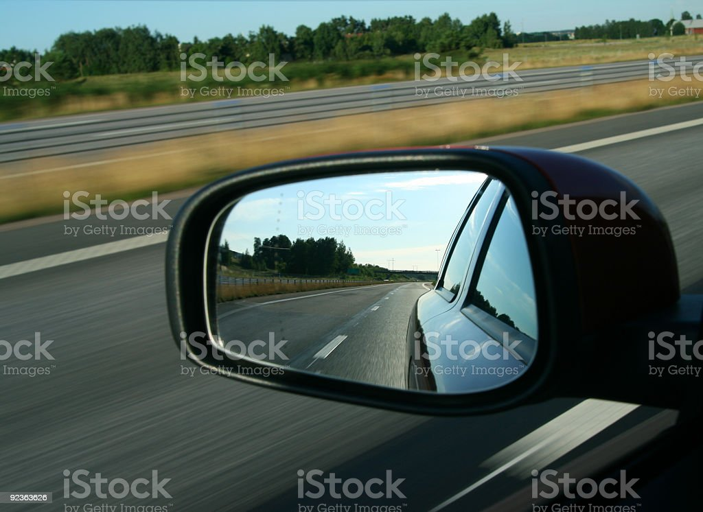 Rear view reflected in a car mirror stock photo
