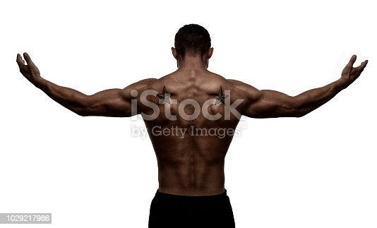 Rear view, silhouette of healthy young sports man with his arms stretched out, isolated on white background