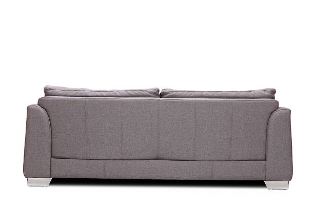 rear view studio shot of a modern gray sofa - rear view stock photos and pictures