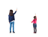 rear view two kids drawing isolated on white